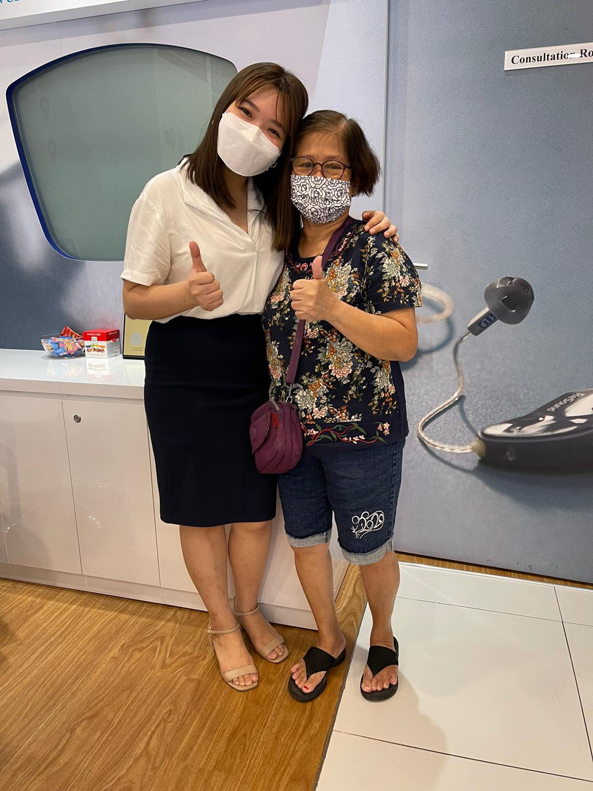 Hearing Consultant Faith with patient at Serangoon Hearing centre
